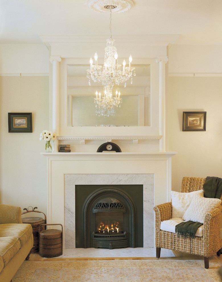 Ornate living room photo in Portland with beige walls and a standard fireplace