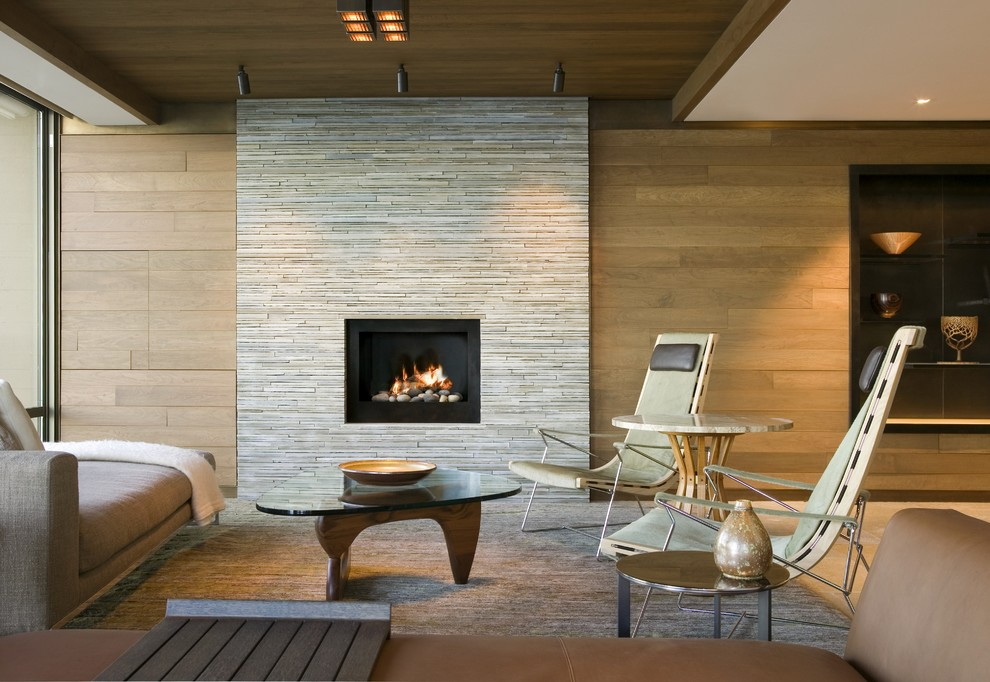 Living room - mid-sized contemporary formal and open concept brown floor living room idea in Seattle with brown walls, a standard fireplace, a stone fireplace and no tv