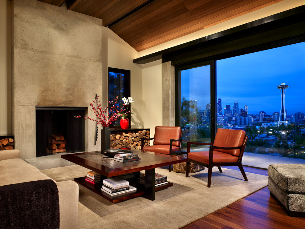 Mid-sized trendy formal and open concept medium tone wood floor and brown floor living room photo in Seattle with a concrete fireplace, a standard fireplace, beige walls and no tv