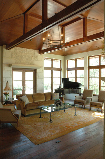 Living room grand piano vaulted ceiling wood planked for Vaulted ceiling with exposed trusses