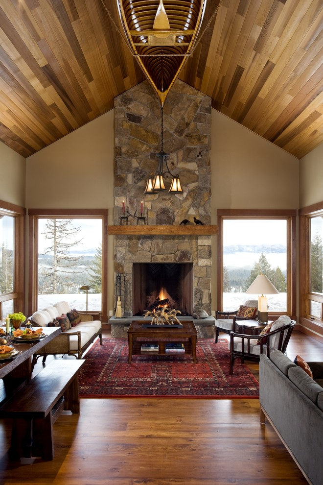Mountain style living room photo in Boise with a stone fireplace