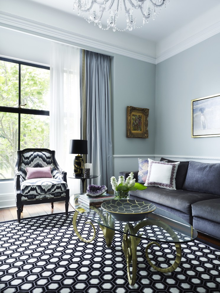 Example of a transitional living room design in Sydney with blue walls