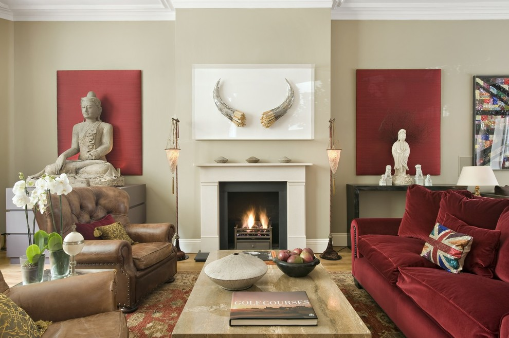 Transitional formal living room photo in London with beige walls and a standard fireplace