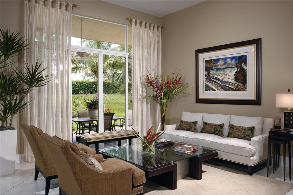 Living room - contemporary living room idea in Miami with beige walls