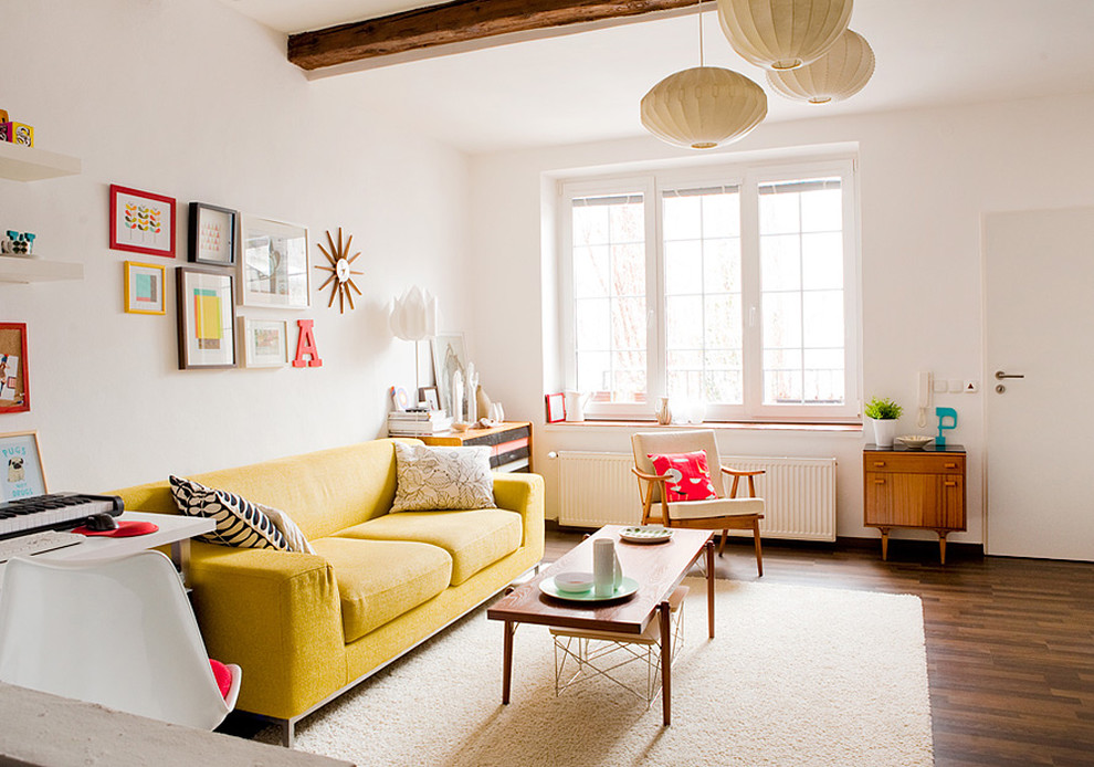 Inspiration for a scandinavian living room remodel in Other with white walls