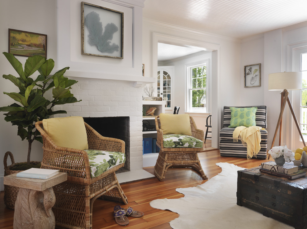 Beach style living room photo in Providence with white walls