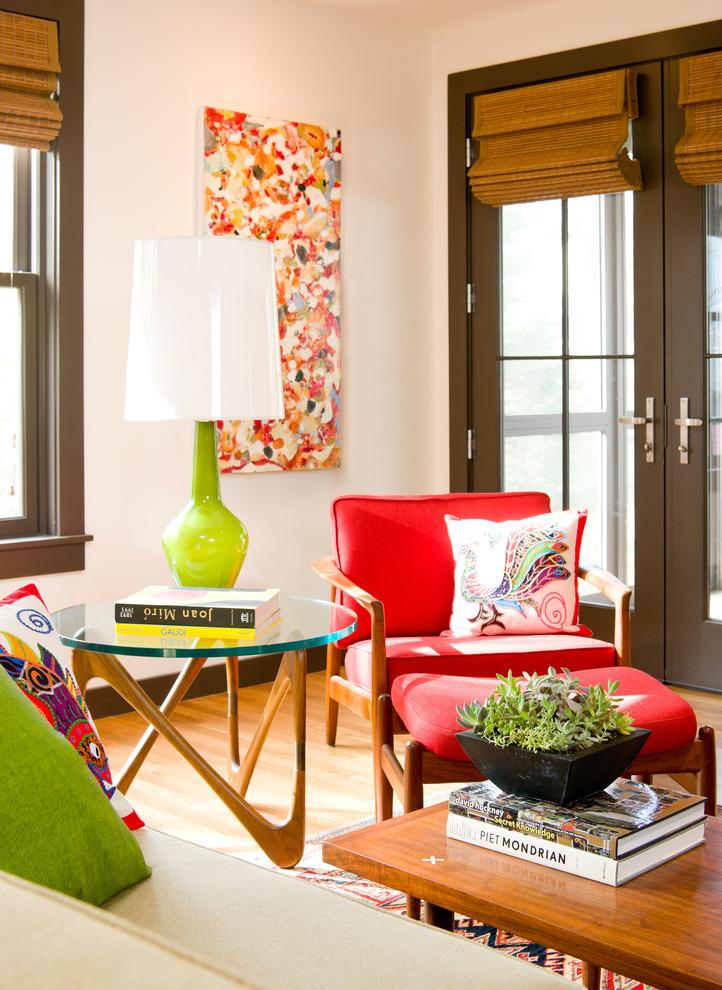 Midcentury modern medium tone wood floor living room photo in Boston
