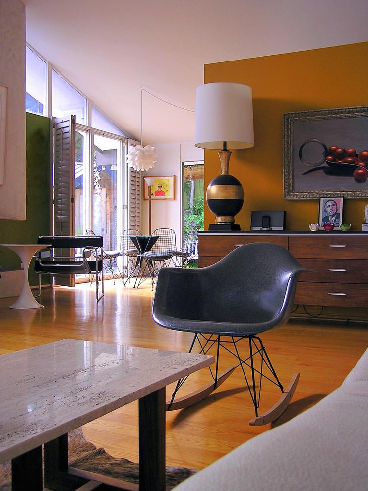 Living room - 1960s orange floor living room idea in Orange County with orange walls