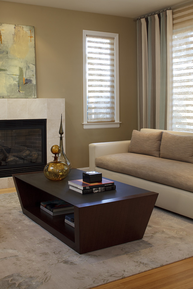 Living room - contemporary living room idea in Dallas with a tile fireplace