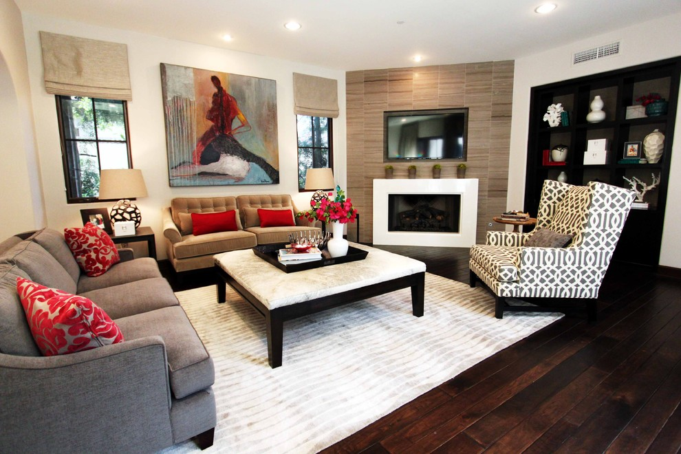 Trendy enclosed living room photo in Orange County with beige walls and a corner fireplace