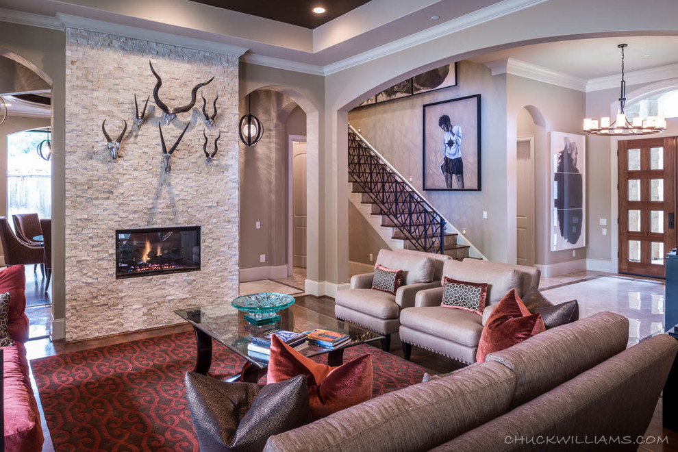 Large tuscan formal and open concept medium tone wood floor living room photo in Houston with beige walls, a two-sided fireplace, a stone fireplace and no tv