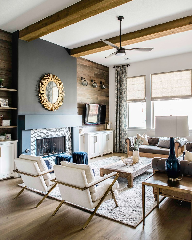 Mid-sized transitional enclosed medium tone wood floor and beige floor living room photo in Austin with multicolored walls, a standard fireplace, a metal fireplace and a wall-mounted tv