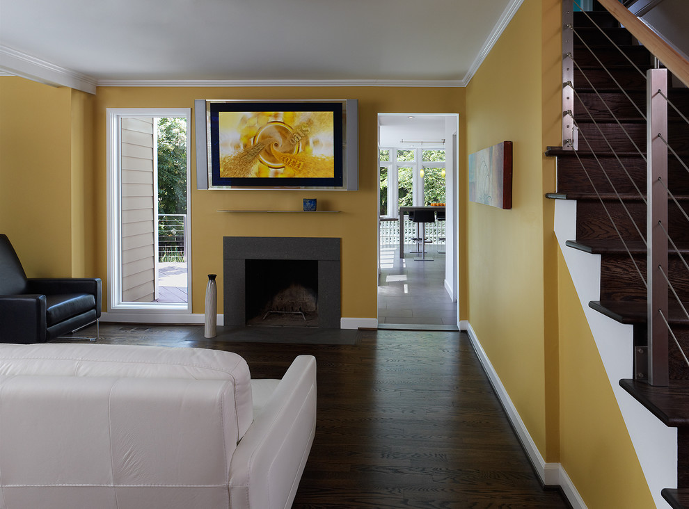 Inspiration for a contemporary black floor living room remodel in DC Metro with a standard fireplace and a wall-mounted tv