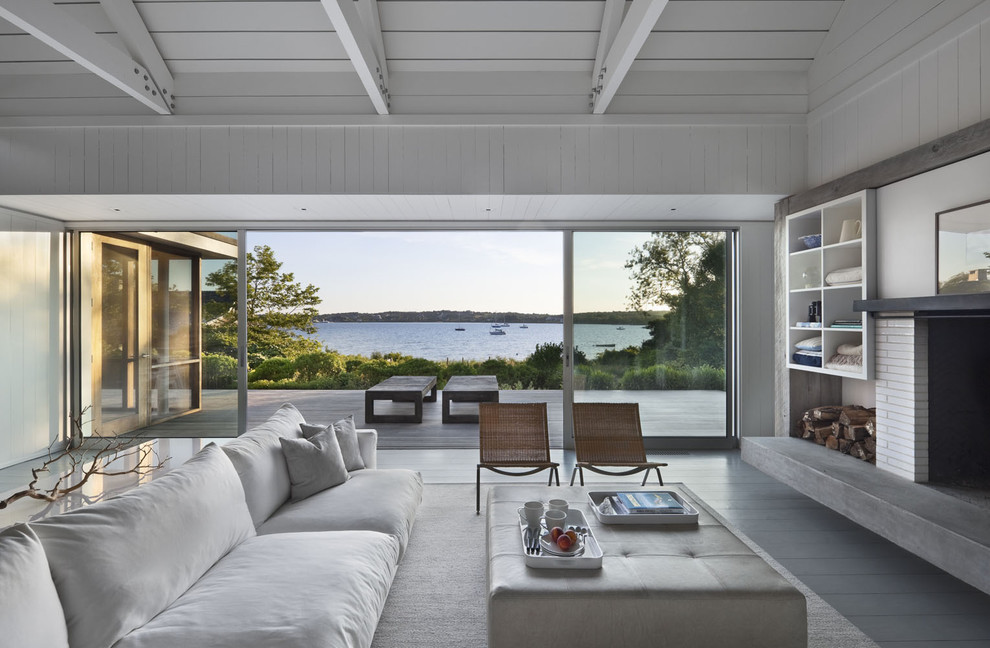 Inspiration for a coastal living room remodel in New York with a standard fireplace and a brick fireplace