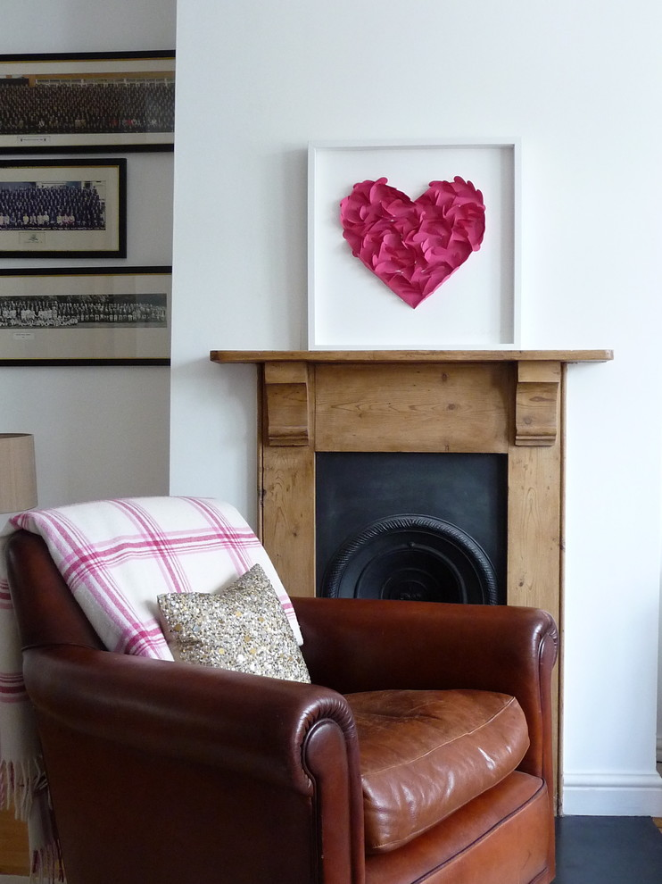 Inspiration for an eclectic living room remodel in London with white walls and a standard fireplace