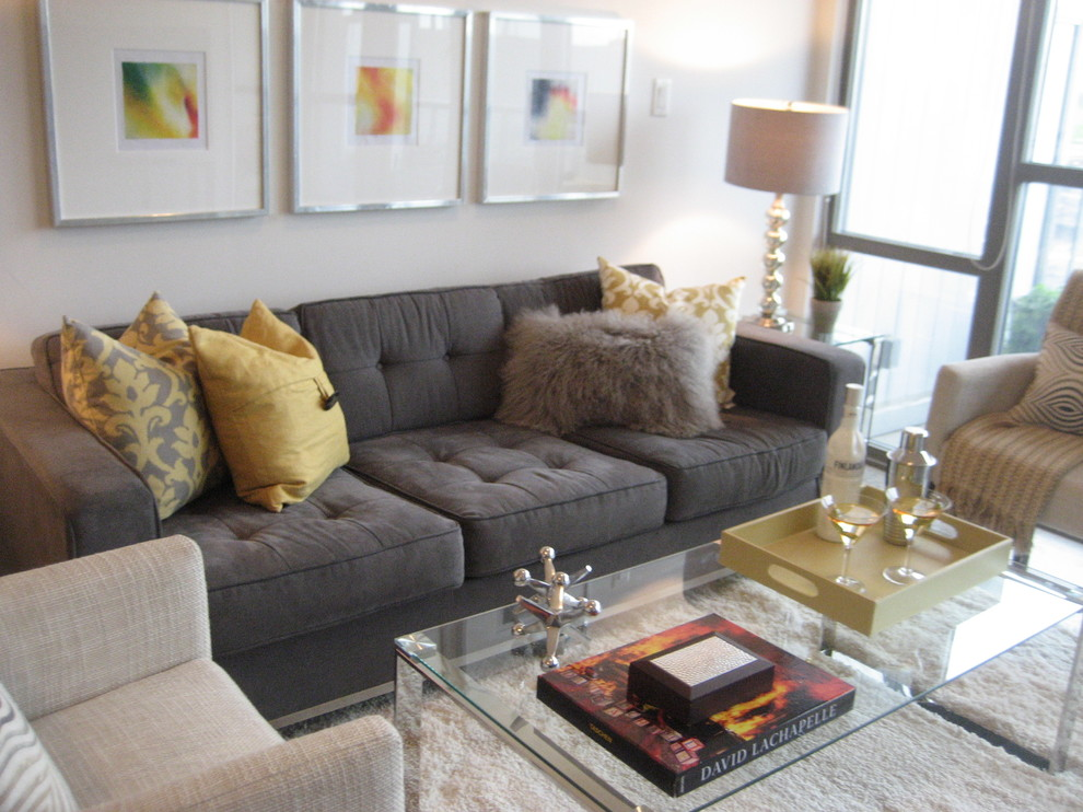 Example of a small trendy open concept and formal concrete floor and gray floor living room design in Toronto with gray walls, a tv stand and no fireplace