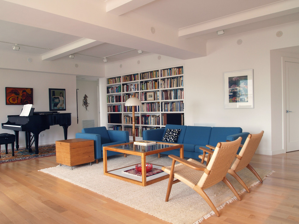 Large minimalist living room photo in New York with a music area and white walls