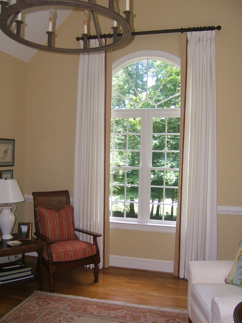 Living room tall arched window living room richmond for Window treatment for oval window