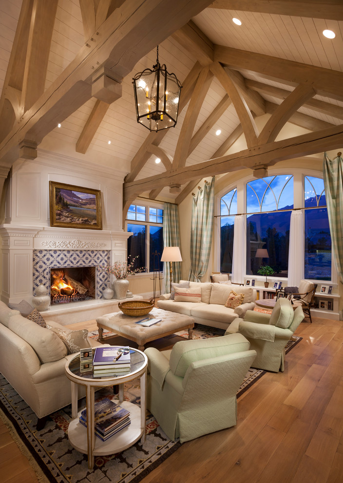 Inspiration for a large timeless formal and enclosed medium tone wood floor and brown floor living room remodel in Salt Lake City with a standard fireplace, a tile fireplace, white walls and no tv