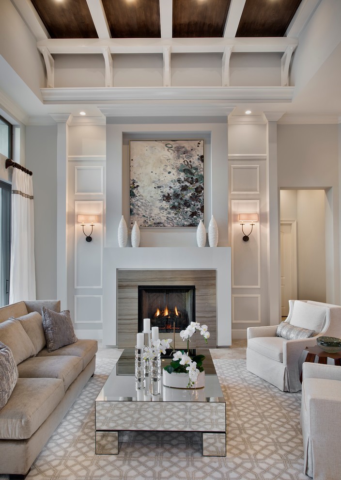Living room - transitional formal and enclosed living room idea in Miami with gray walls and a standard fireplace