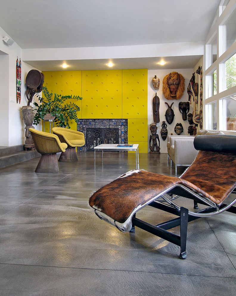 Example of an eclectic concrete floor living room design in Portland with a standard fireplace and a tile fireplace