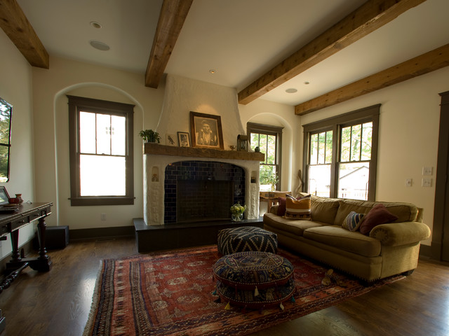 living room with exposed beams and poufs. Black Bedroom Furniture Sets. Home Design Ideas