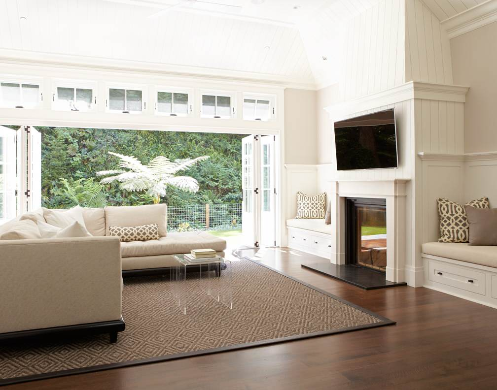 Living room with fireplace and doors that open to outside space