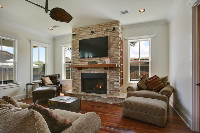 Living room with media hub faux fireplace traditional for Living room ideas new build