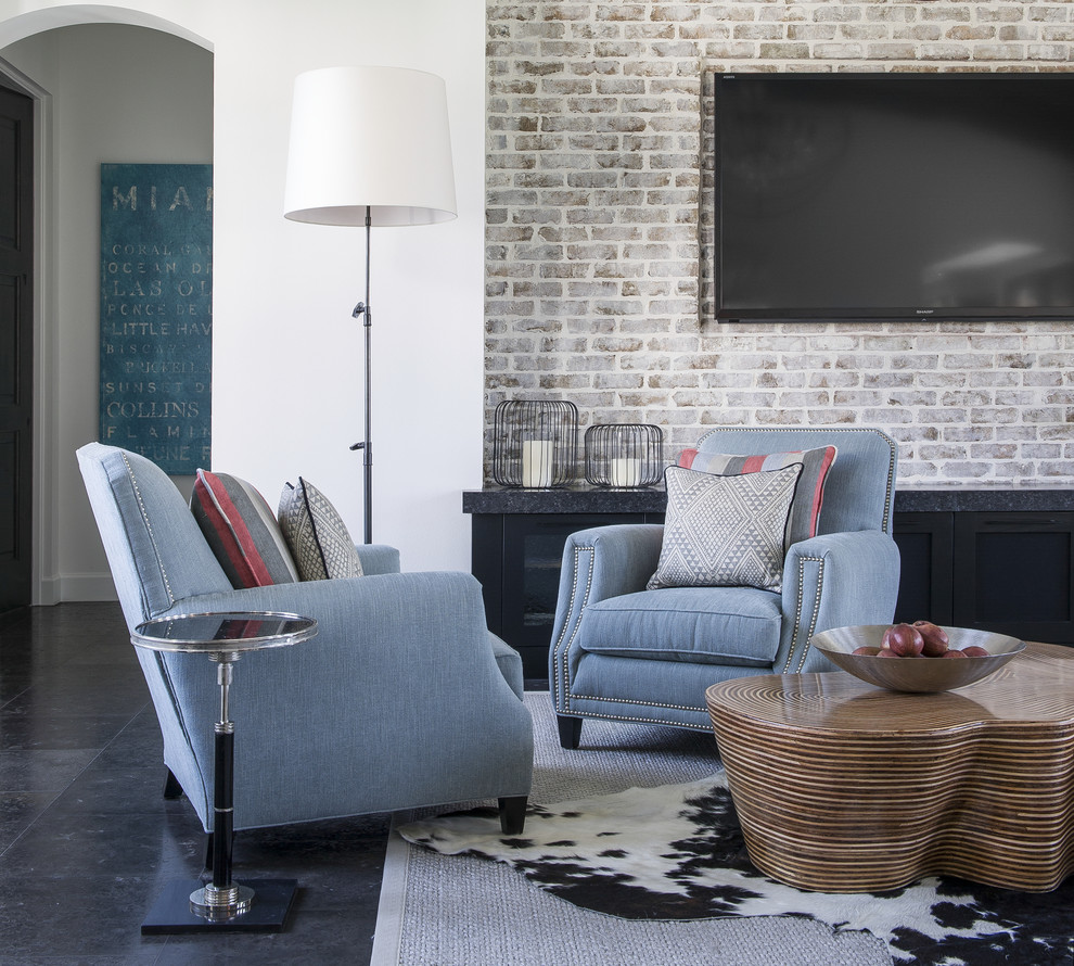 Example of a large eclectic formal and open concept limestone floor living room design in Orlando with white walls and a wall-mounted tv