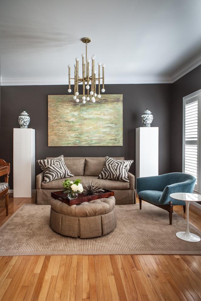 Mid-sized transitional formal and open concept medium tone wood floor and brown floor living room photo in St Louis with gray walls, no fireplace and no tv