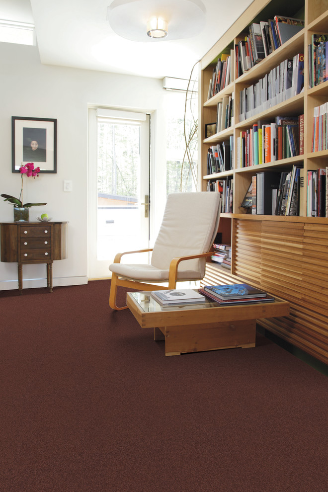 Trendy enclosed carpeted living room library photo in Jacksonville with white walls