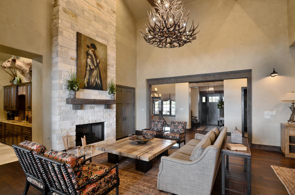 Example of a large living room design in Austin with gray walls, a standard fireplace and no tv
