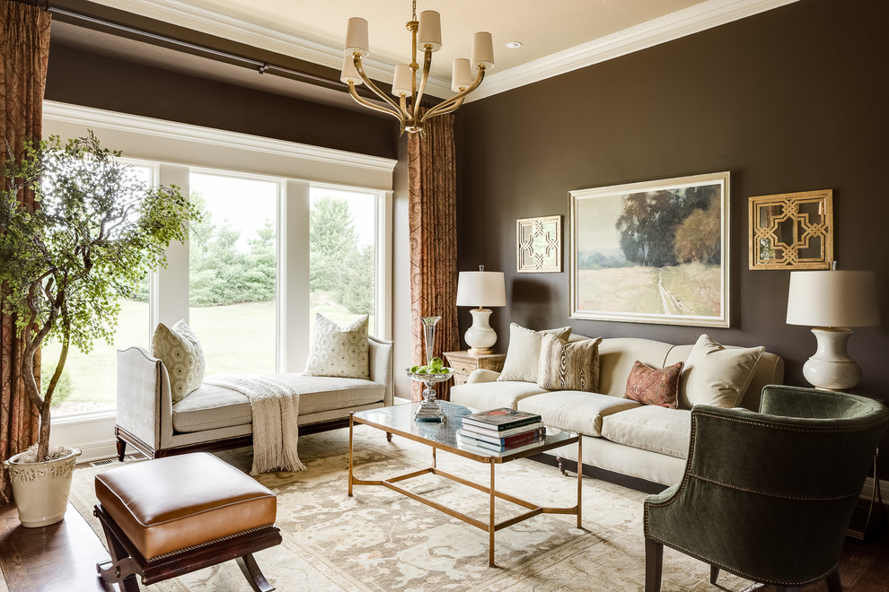 Example of a mid-sized classic formal and enclosed medium tone wood floor living room design in Kansas City with brown walls, no fireplace and no tv