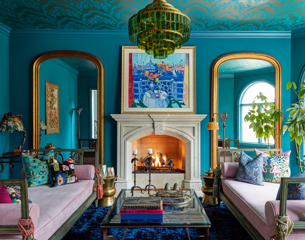 Transitional blue floor and wallpaper ceiling living room photo in Chicago with blue walls, a standard fireplace and a stone fireplace