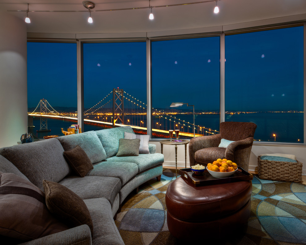 Example of a large trendy open concept light wood floor living room design in San Francisco with white walls