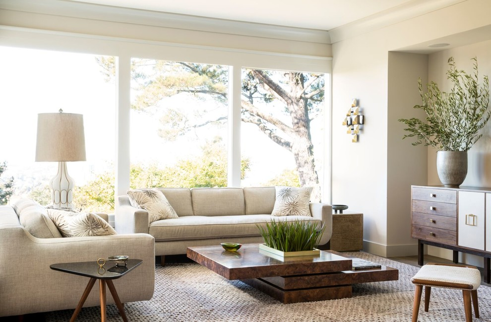 Inspiration for a contemporary formal living room remodel in New York with beige walls