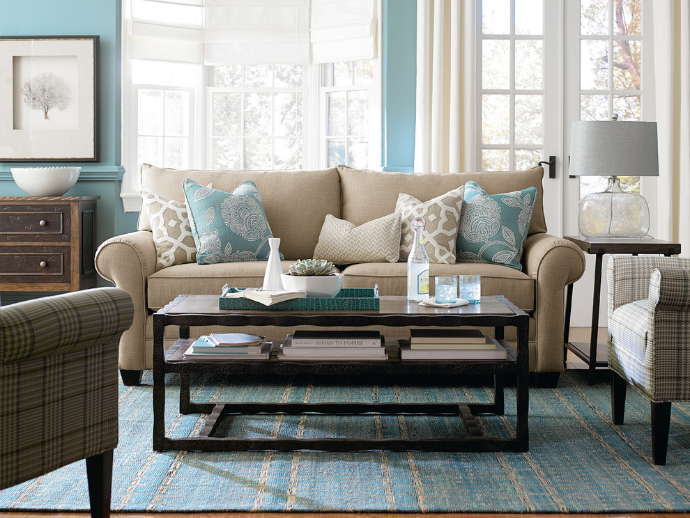 Inspiration for a mid-sized transitional open concept and formal light wood floor living room remodel in Jacksonville with blue walls