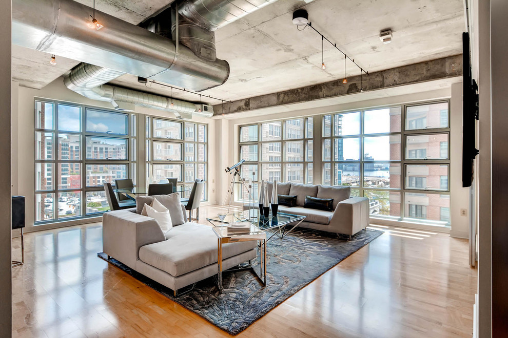 Example of an urban formal and open concept light wood floor living room design in Baltimore with a wall-mounted tv