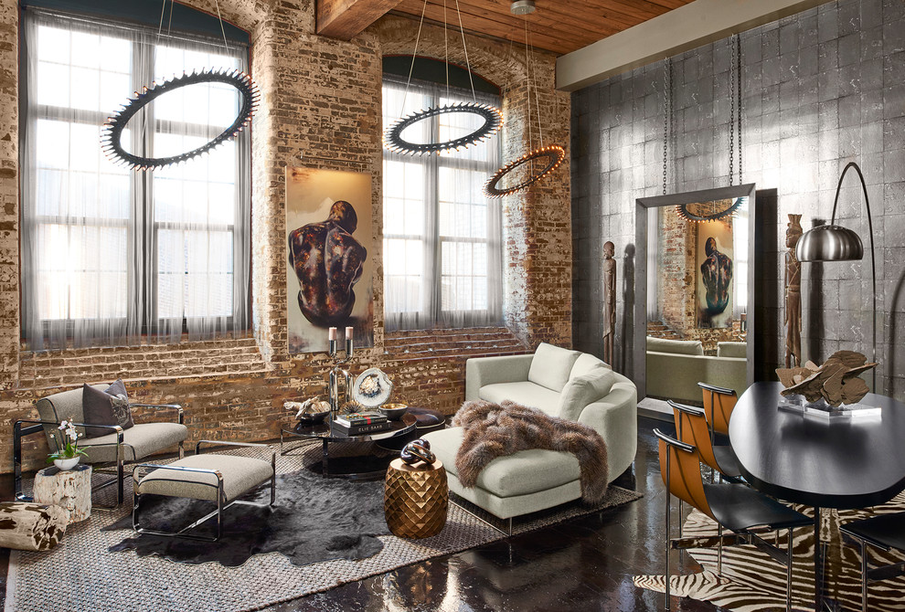 Living room - mid-sized industrial formal and open concept black floor and concrete floor living room idea in Atlanta with gray walls