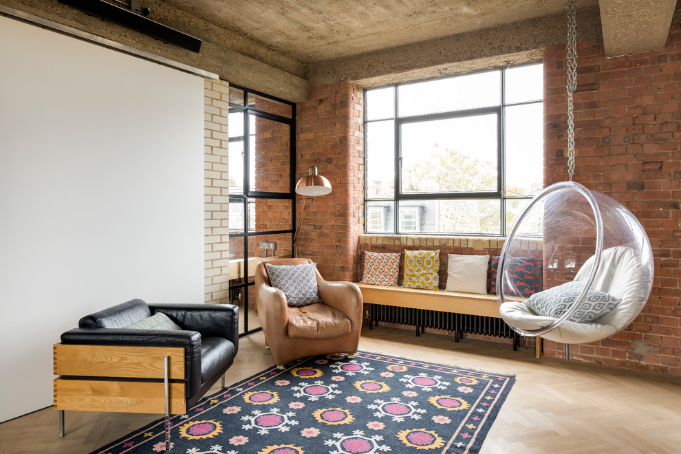 Urban light wood floor and beige floor living room photo in London with white walls