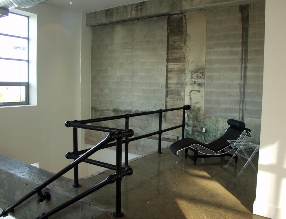 Living room - industrial concrete floor living room idea in Toronto