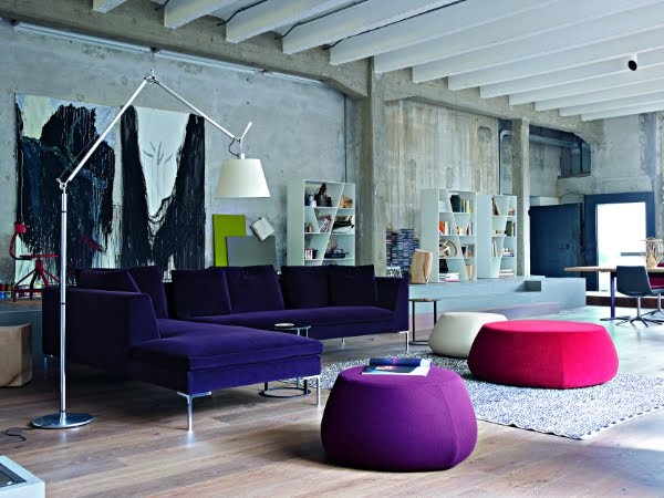 Loft space with colorful couches contemporary-living-room