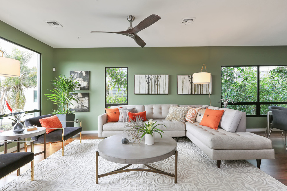 Inspiration for a transitional formal and open concept medium tone wood floor and brown floor living room remodel in San Francisco with green walls