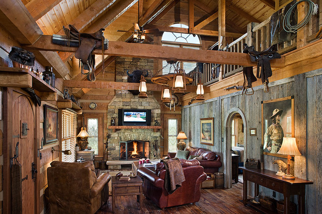 Log home with barn wood and western decor traditional for Western home builders