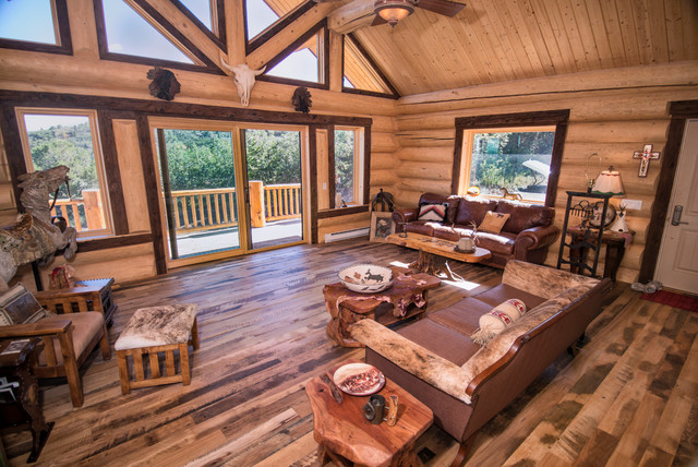 Log home with mushroom wood trim accent and skipped l  : rustic living room from www.houzz.com size 640 x 428 jpeg 132kB