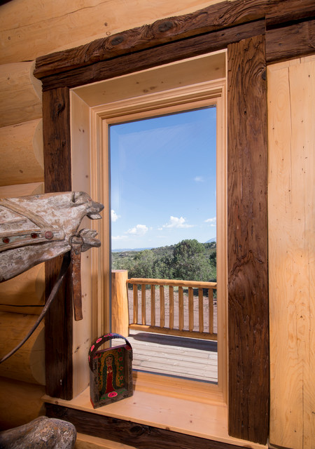 Log Home With Mushroom Wood Trim Accent