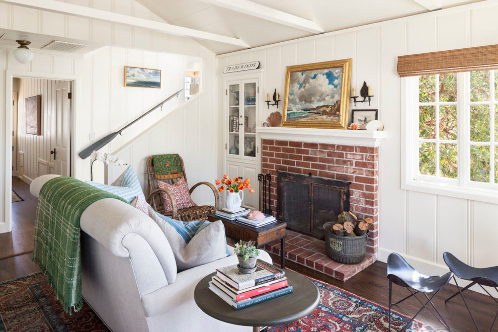 Inspiration for a small coastal formal and enclosed dark wood floor living room remodel in Orange County with white walls, a standard fireplace, a brick fireplace and no tv
