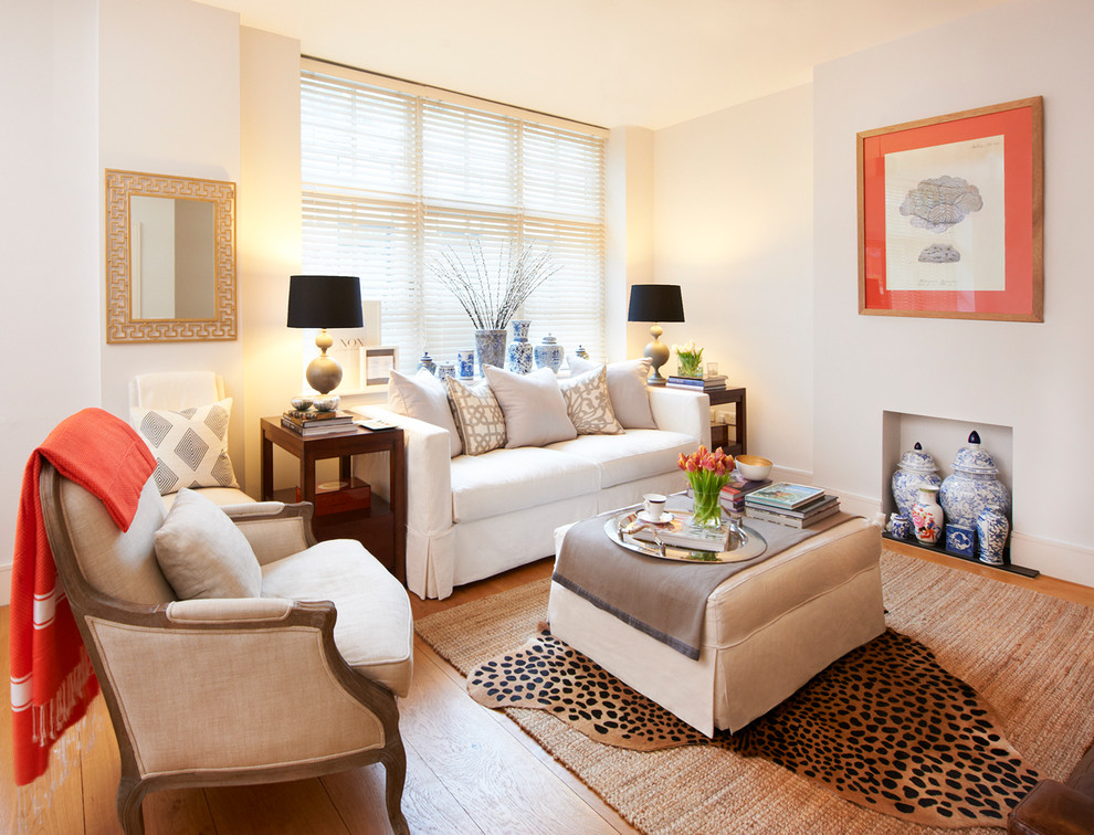 Example of a transitional formal living room design in London with beige walls