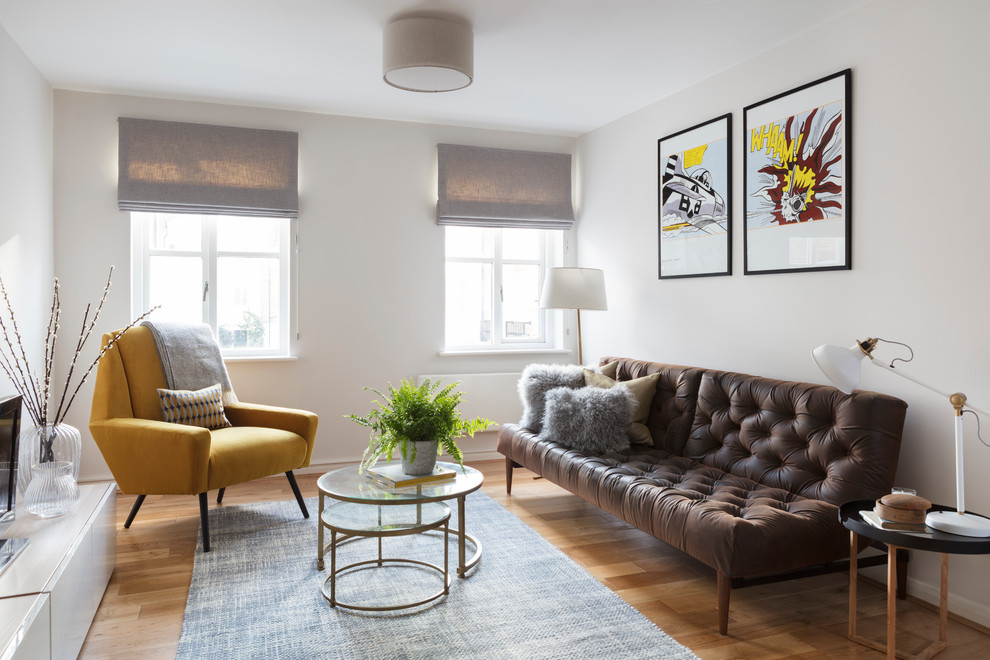 Small trendy open concept and formal light wood floor and beige floor living room photo in London with gray walls