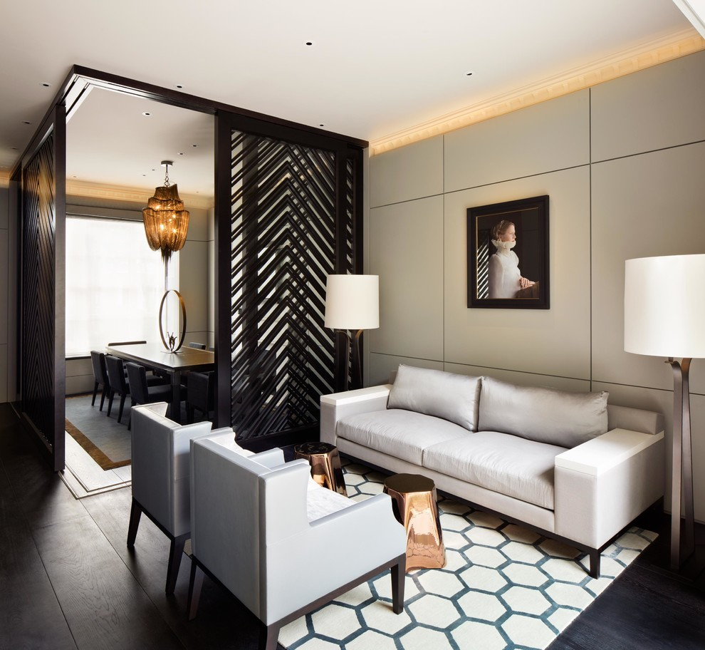 Inspiration for a mid-sized transitional enclosed dark wood floor and brown floor living room remodel in London with gray walls